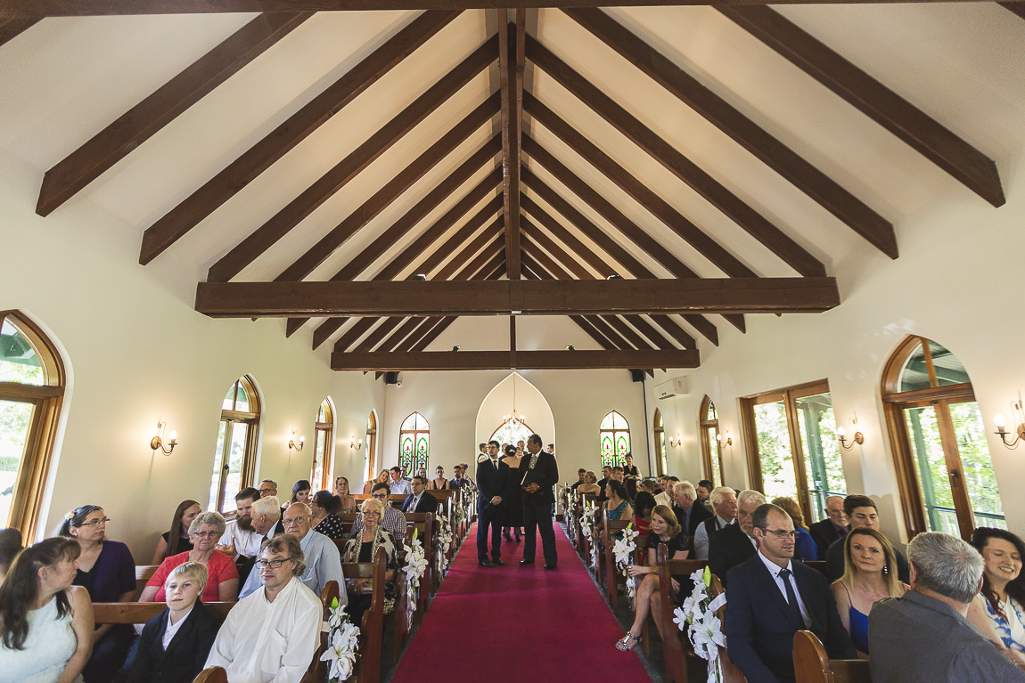 Wedding guests waiting for the bride's arrival at a chapel